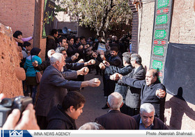 Locals jingle rattles on Tasu'a, Ashura in Abyaneh, Isfahan
