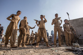 مراسم گل مالی خرم آبادیهای مقیم فولادشهر بمناسبت عاشورا
