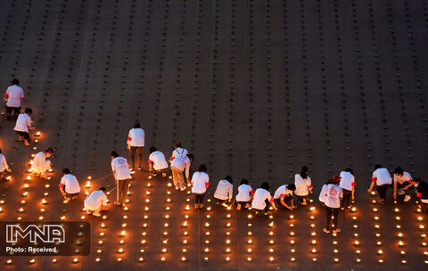 روشن کردن 330 هزار شمع برای گرامیداشت روز زمین و شکستن رکورد گینس در معبد Dhammakaya استان پاتوم تانی تایلند